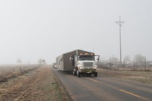 Truck transporting a house