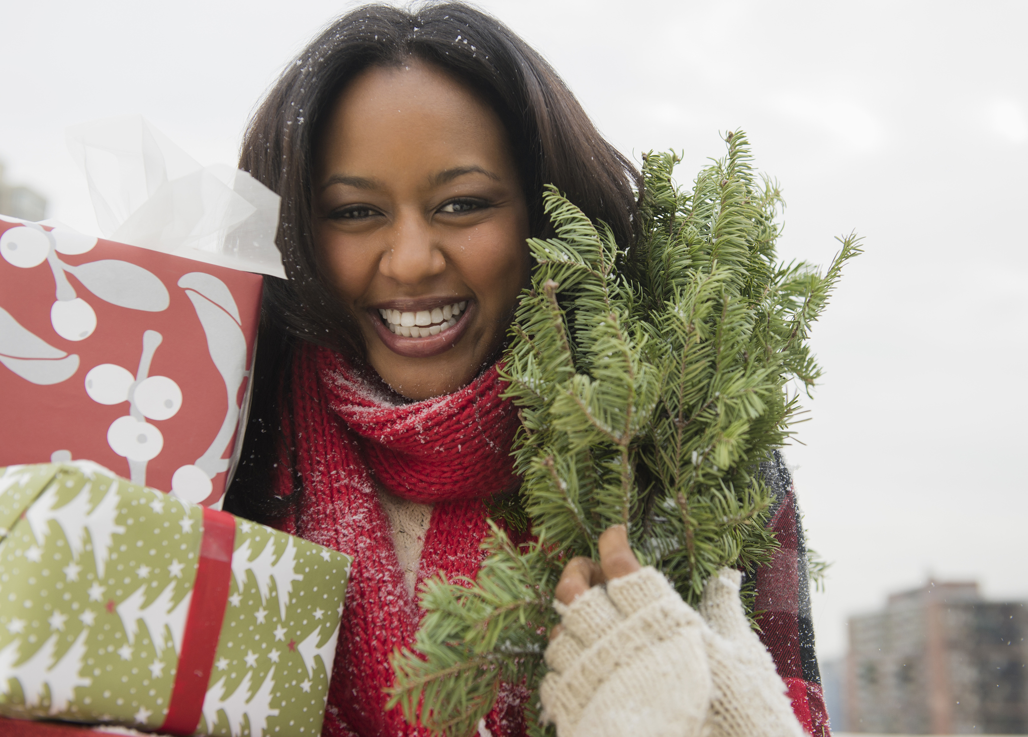 African American woman carrying Christmas presents