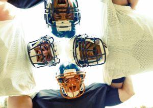 American Football Players Huddling