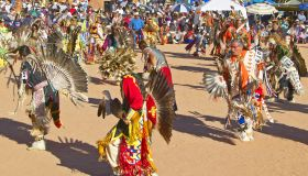 Native Americans in full regalia dancing at Pow wow