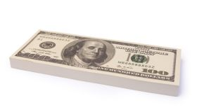 Close-Up Of Us Paper Currency Bundle Over White Background